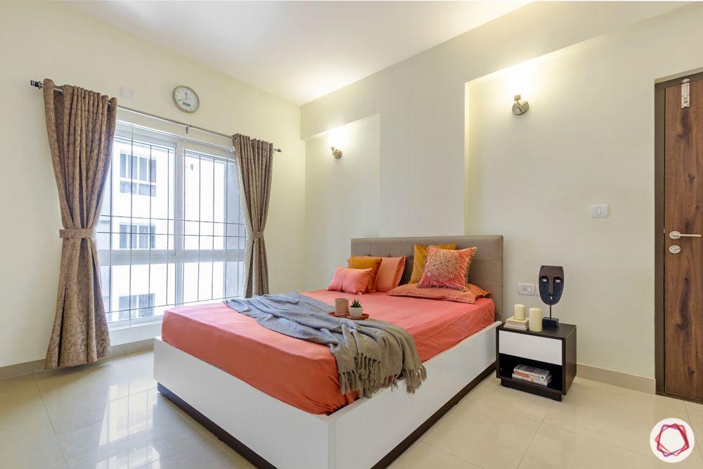 Salarpuria Sattva Aspire-bedroom-orange-sheets-wall-niche