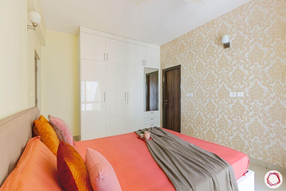 bedroom-orange-sheets-wall-niche-wardrobe-dresser-mirror