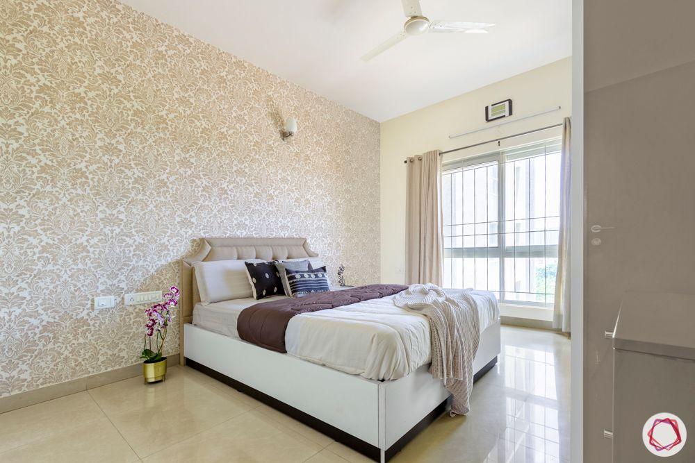 guest-bedroom-neutral-wallpaper-window-white-floor