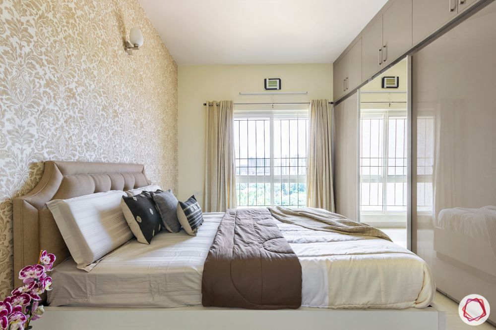 guest-bedroom-neutral-headboard-window-bright-wardrobe-mirror