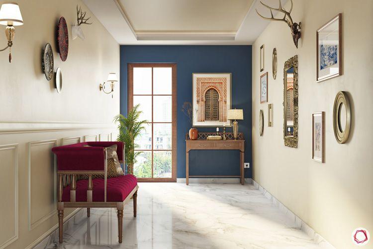 irrfan khan-foyer-blue accent wall-wall art-wooden furniture