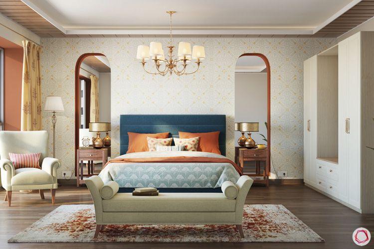irrfan khan-chandelier-bedroom-blue headboard-armchair-floor lamp