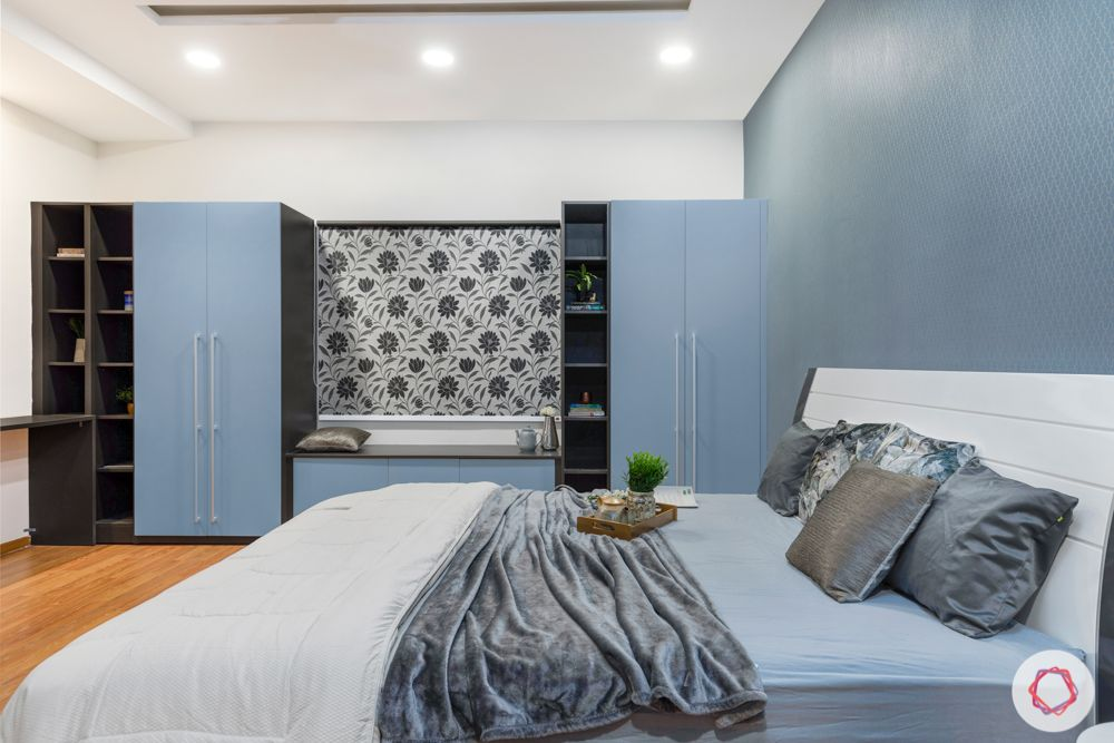 top interior designers in hyderabad-master bedroom-white bed-blue wardrobes-grey wallpaper