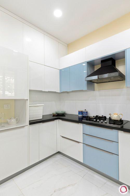 interior design in hyderabad-kitchen-tall unit-chimney-acrylic finish-granite countertop