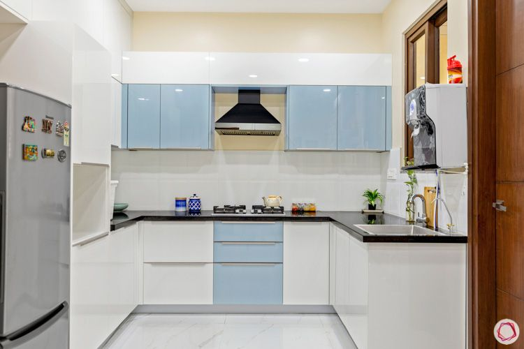 interior design in hyderabad-kitchen-tall unit-chimney-acrylic finish-granite countertop-fridge-profile shutters