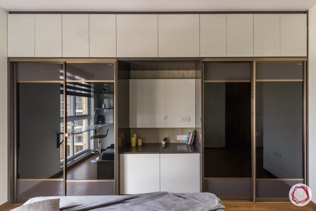 livspace wardrobe design-dark reflective wardrobes-sliding door-wardrobe with tv unit