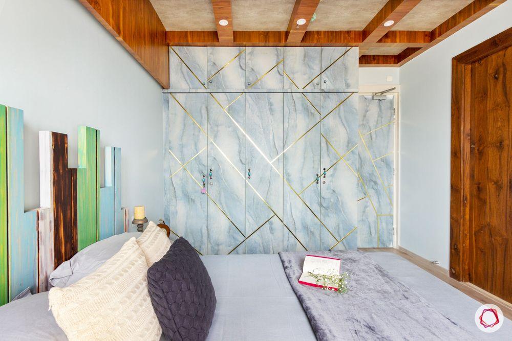 livspace wardrobe design-sky blue wardrobes-gold detailing-wooden ceiling