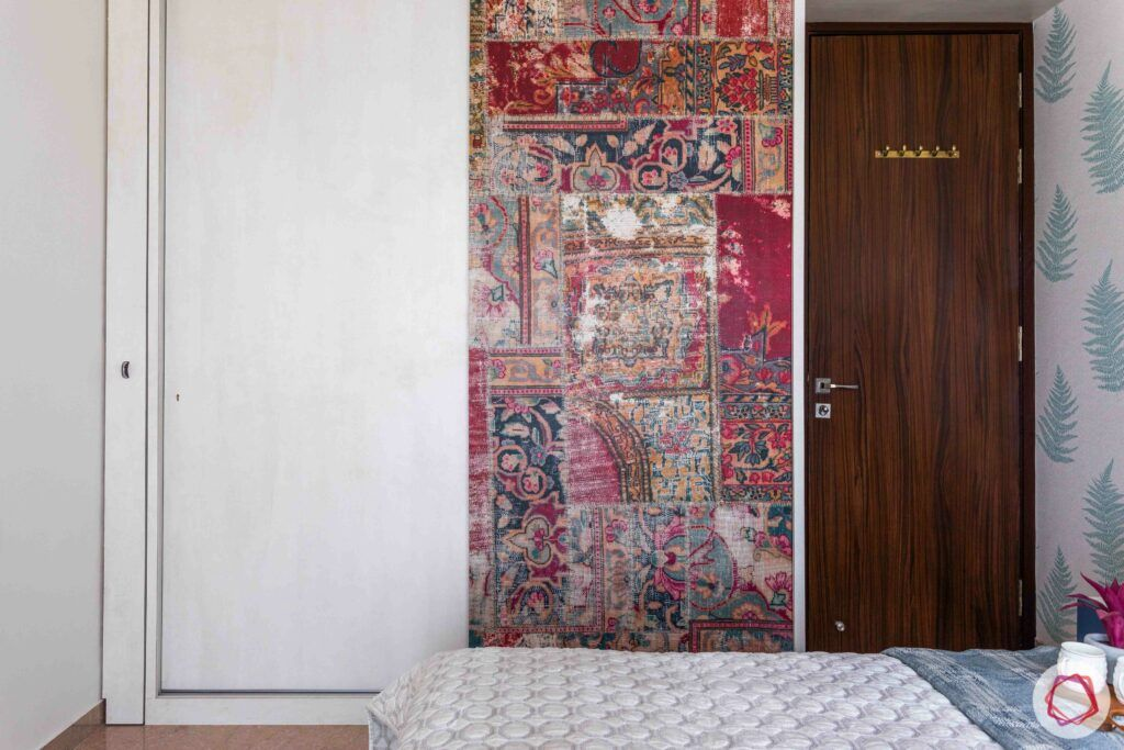 livspace wardrobe design-red wardrobe-morrocan pattern-white door