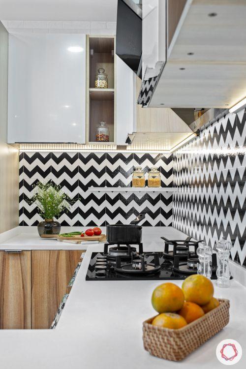 Livspace kitchen-open kitchen design-zigzag backsplash-pendant lights-tall unit
