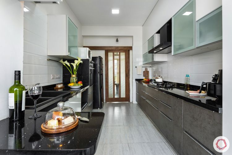Livspace kitchen-parallel kitchen-white wall cabinets-stone grey base cabinets