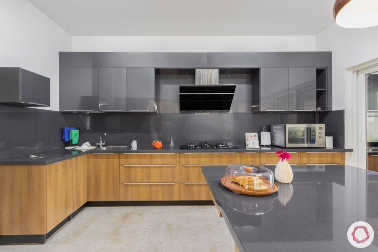 Livspace kitchen-grey wall cabinets-kalinga stone countertop-walnut finish membrane