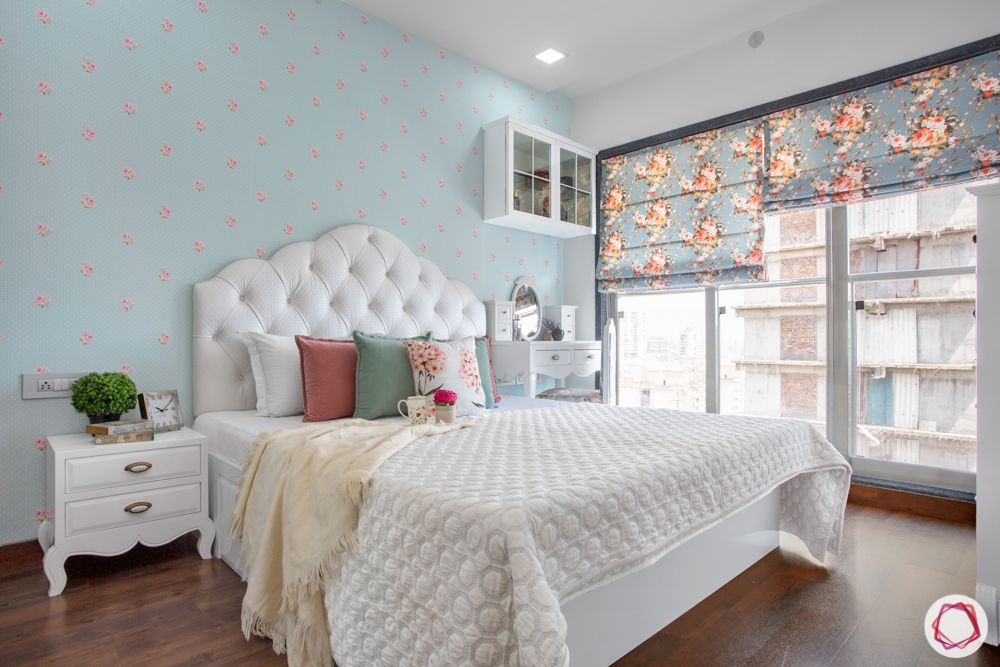 low budget home design-pastel wallpaper-floral blinds-white cushioned headboard