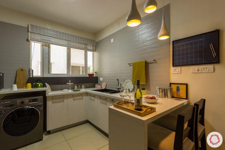 Livspace kitchen-modern kitchen-white base cabinets-breakfast counter-pendant light