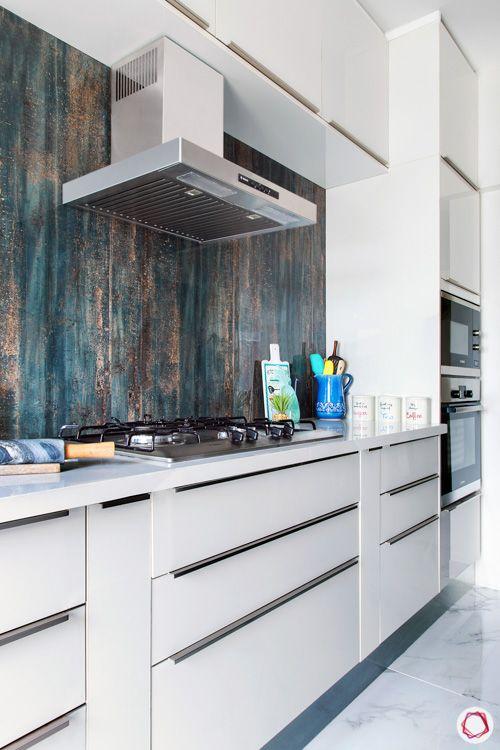 small compact kitchen ideas-white cabinets-blue design backsplash-no handles-chimney-hob