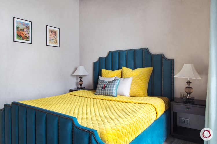 small room ideas-blue velvet bed-bedside lamps-compact bedroom-yellow bedding