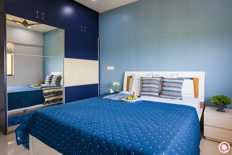 blue wardrobe designs-side table designs-white bed designs-compact room-blue themed bedroom