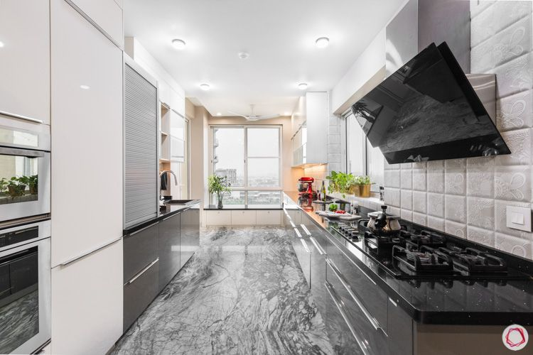 4 bhk flat-grey and white kitchen designs-grey tiled backsplash-tall unit-shutter cabinets-grey lower cabinets-window seating