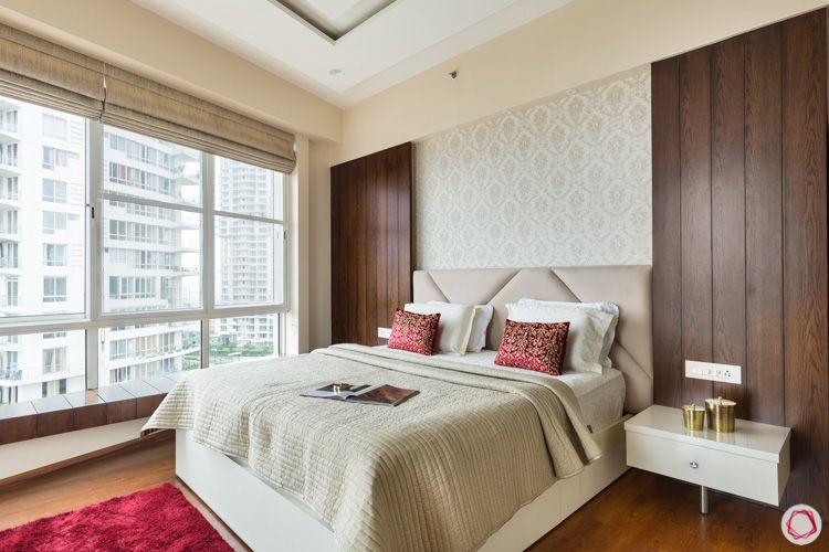 wooden panelling-beige headboard-white bed designs-gold motif wallpaper