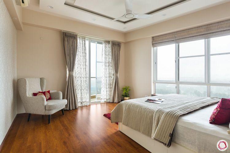 white armchair-false ceiling-bedroom balcony-gold motif wallpaper