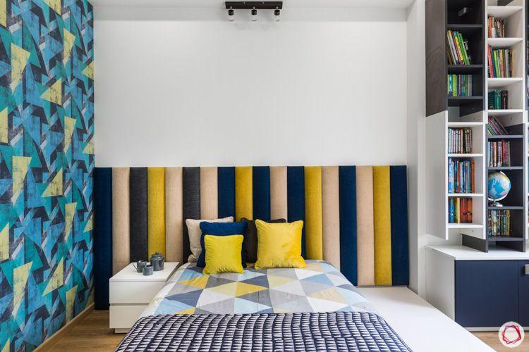 multi-coloured headboard-cushioned headboard-bookshelf-accent wall designs-geometric wallpape