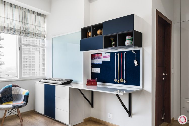 4bhk flat-study unit designs-blue and white study unit-open and close cabinets-collapsable table