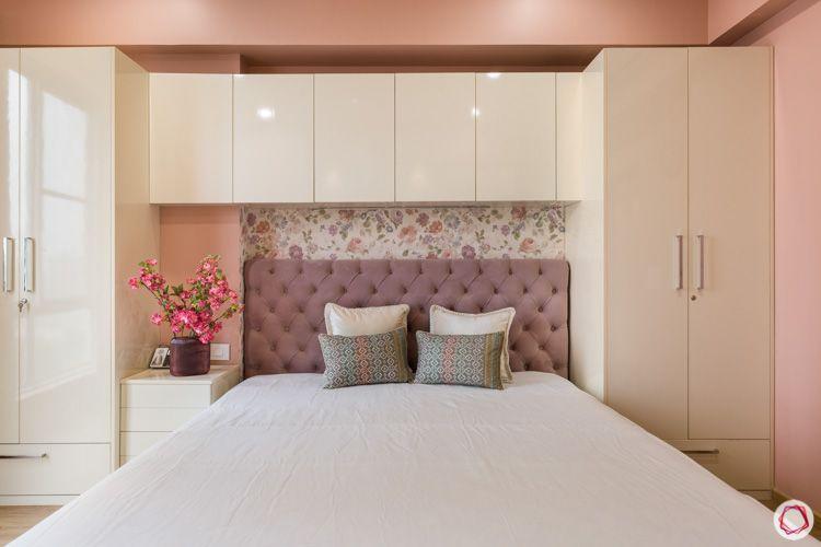 pink cushioned headboard--swing door wardrobe-floral wallpaper designs-false ceiling-spot lights