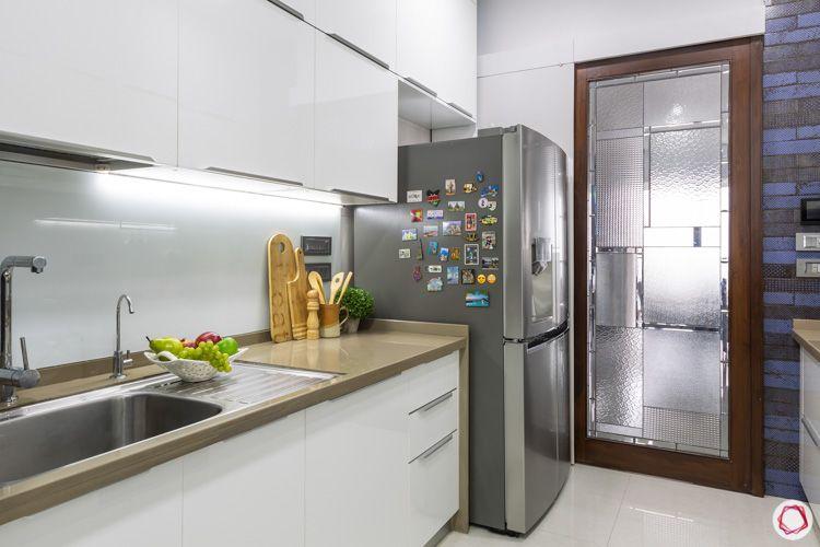 white-modular-kitchen-brown-countertop-fridge-lofts