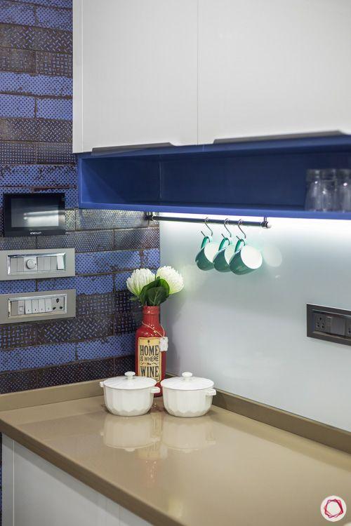 white-modular-kitchen-blue-ceramic-tiles-wall-shelves