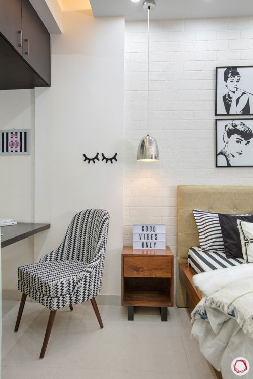 slipper-chair-comfort-black-white-wooden-legs