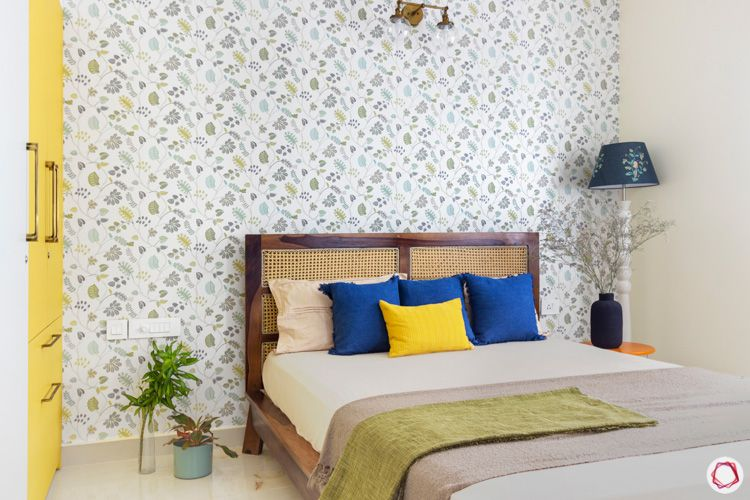 mesh-wooden bed-blue cushions-blue and white standing lamp