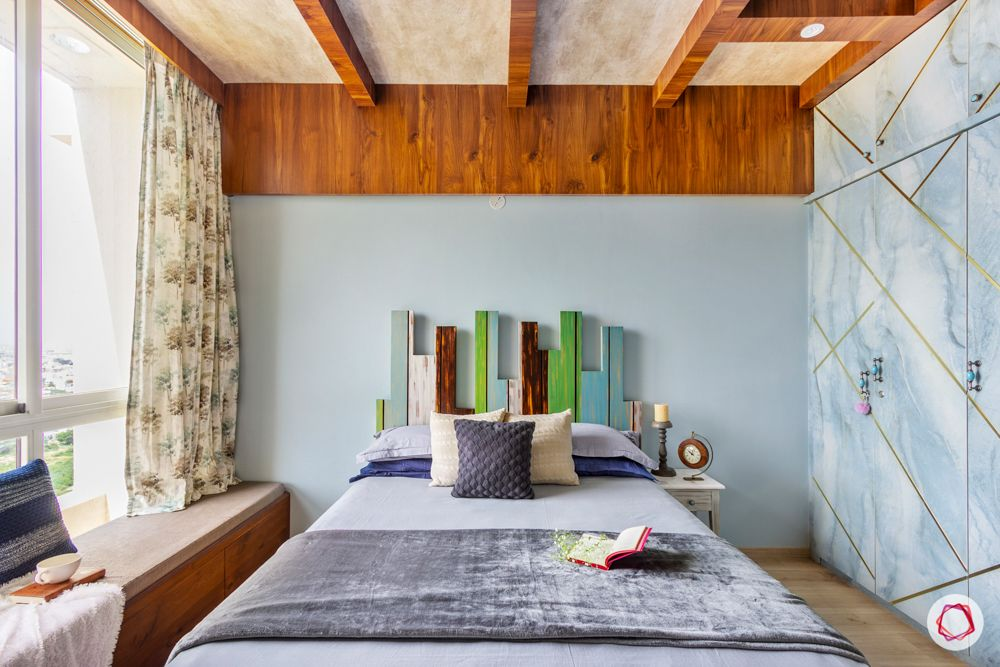 mulit-coloured bed-blue wardrobe-bay seating-ceiling wooden rafters