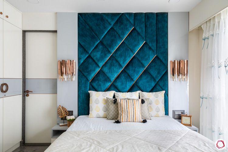 blue velvet-wall-mounted lamps-pattern-blue headboard