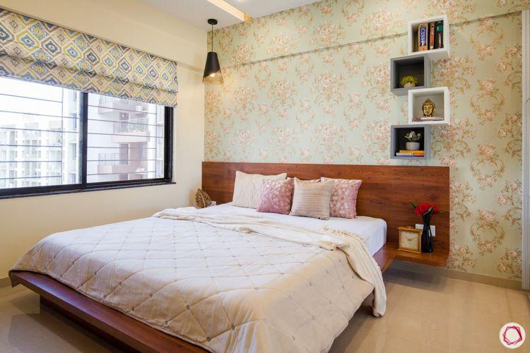 wooden bed-floral wallpaper-floating shelves
