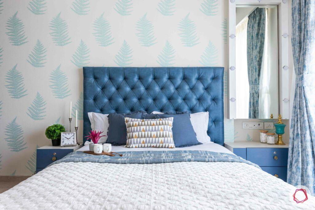 cushioned headboard-blue room-vanity unit-blue side table