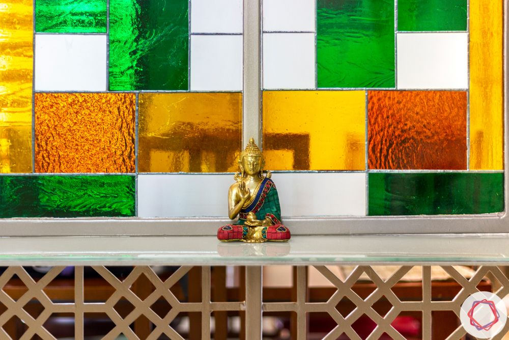 nambiar bellezea-dining room-stained glass-buddha statues-colourful glass-CNC Jaali