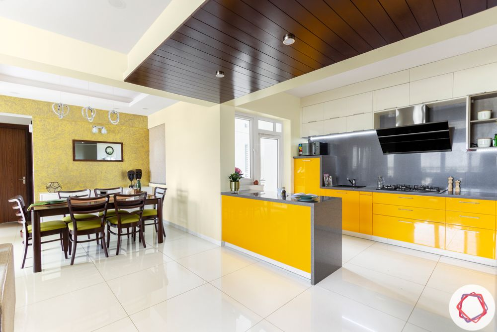 Alembic Urban Forest-dining-kitchen-yellow-olive-white-tiles-wood-ceiling