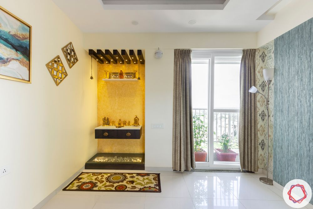 3BHK interior design-pooja-unit-textured-paint-wooden-rafters-light