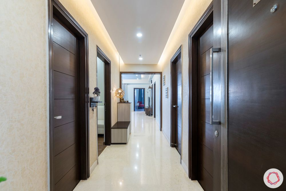 3 bhk interior design-entryway-veneered doors-textured wallpaper-false ceiling