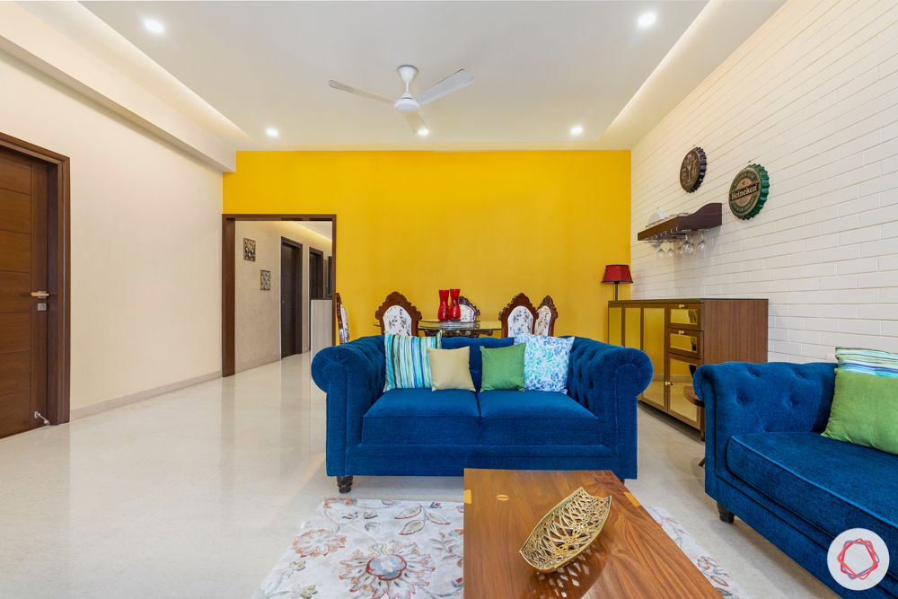 3 bhk interior design-yellow accent wall-refurbished furniture-minimal bar unit-crockery unit