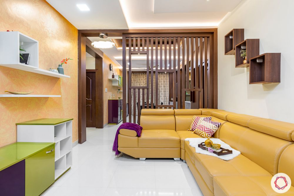 madhavaram serenity-living room-yellow sofa set-wooden partition-green and purple cabinets