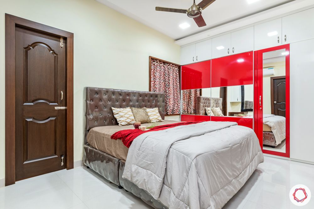 madhavaram serenity-Master Bedroom-red and white wardrobes-brown bed