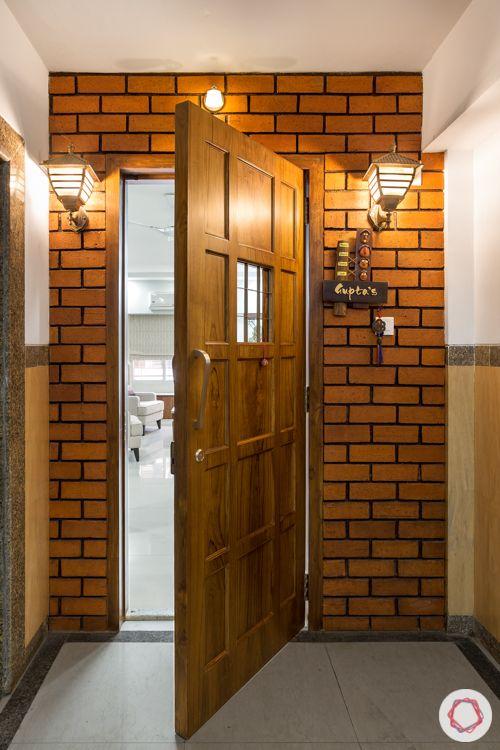 brick wall-wooden door-mounted lamps