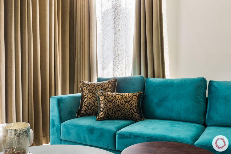 ace-golfshire-noida-interiors-blue-sofa-throwpillows