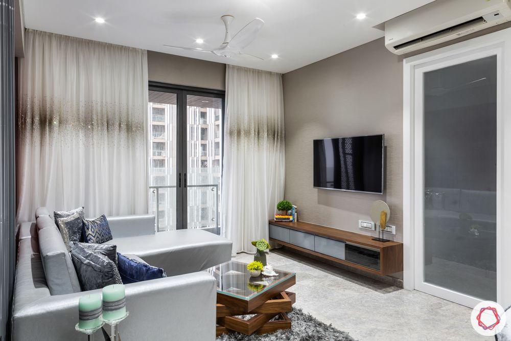lodha-elisium-living-room-veneer-tv-unit-brown-wallpaper