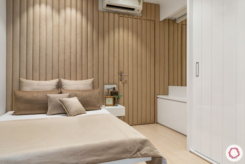 lodha-elisium-guest-bedroom-leather-panelling