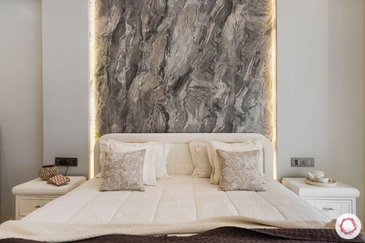 marble wallpaper-white vintage bed-backlighting-white sideboards`