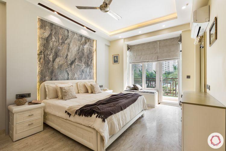 Livspace noida-marble wallpaper-bay seating-gold highlights-dresser
