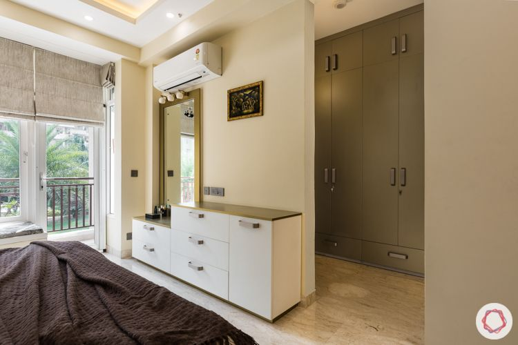 Livspace noida-bay seating-gold highlights-dresser