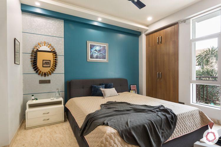 Blue accent wall-silver laminate-wooden dresser