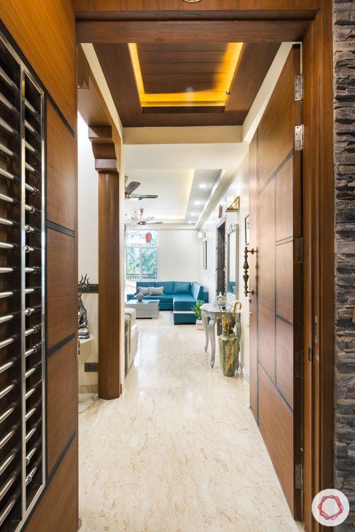 Livspace noida-wooden false ceiling-backlighting-veneered doors